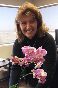 Dr. Tassy Parker with a flower.